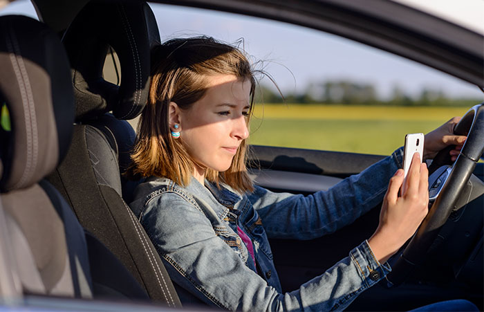 Driving distracted : Survey finds more smartphone use behind the wheel